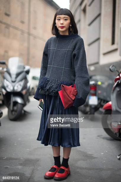 A guest poses after the Max Mara show during Milan Fashion Week Fall/Winter 2017/18 on February 23 2017 in Milan Italy