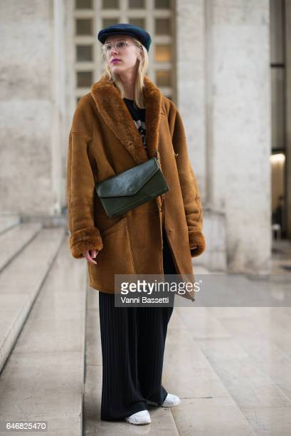 A guest poses after the Rochas show at the Palais de Tokyo during Paris Fashion Week Womenswear FW 17/18 on March 1 2017 in Paris France