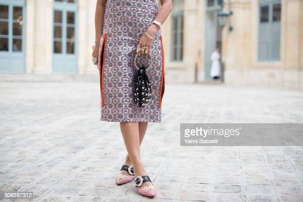 A guest poses after the Schiaparelli show at Place Vendome during Paris Fashion Week Haute Couture FW 17/18 on July 3 2017 in Paris France