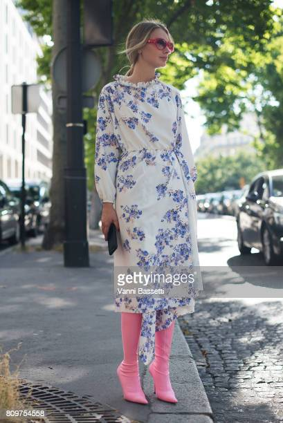 A guest poses after the Valentino show at the Hotel Salomon de Rothschild during Paris Fashion Week Haute Couture FW 17/18 on July 5 2017 in Paris...