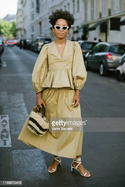 Guest poses after the Valentino Show during Paris Fashion Week - Haute Couture Fall/Winter 2019/2020 on July 03, 2019 in Paris, France.