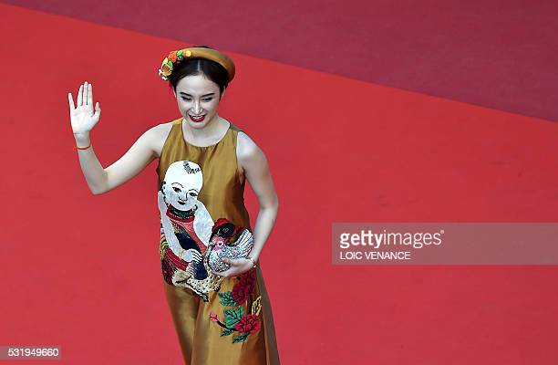 A guest poses as she arrives on May 17 2016 for the screening of the film 'Julieta' at the 69th Cannes Film Festival in Cannes southern France / AFP...