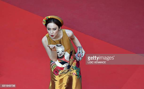 TOPSHOT A guest poses as she arrives on May 17 2016 for the screening of the film 'Julieta' at the 69th Cannes Film Festival in Cannes southern...