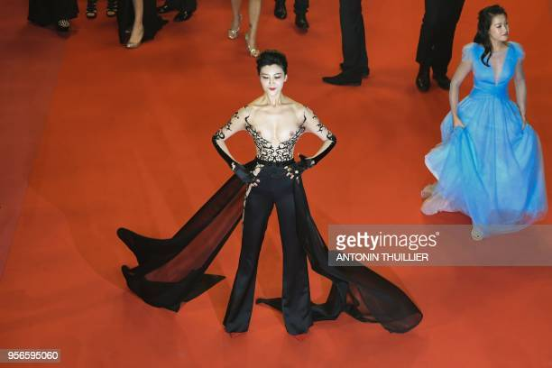 A guest poses as she arrives on May 9 2018 for the screening of the film Leto at the 71st edition of the Cannes Film Festival in Cannes southern...