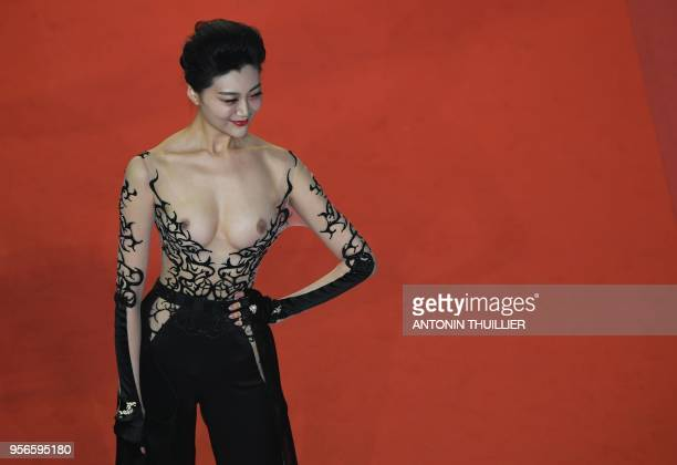 A guest poses as she arrives on May 9 2018 for the screening of the film 'Leto ' at the 71st edition of the Cannes Film Festival in Cannes southern...