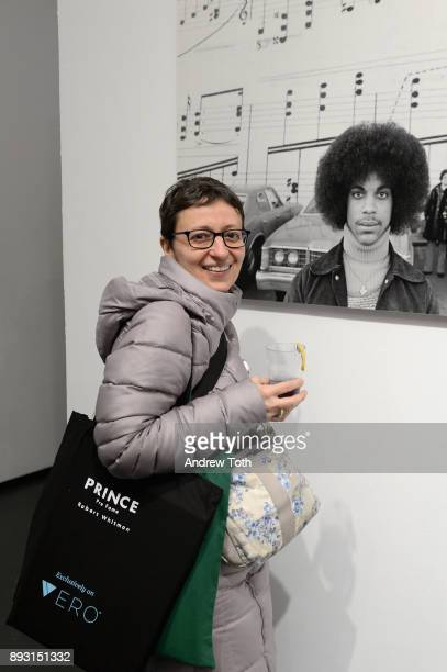 A guest poses at Robert Whitman Presents Prince 'Pre Fame' Private Viewing Event Exclusively On Vero on December 14 2017 in New York City