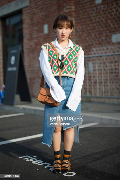 A guest poses before the Gucci show during Milan Fashion Week Fall/Winter 2017/18 on February 22 2017 in Milan Italy