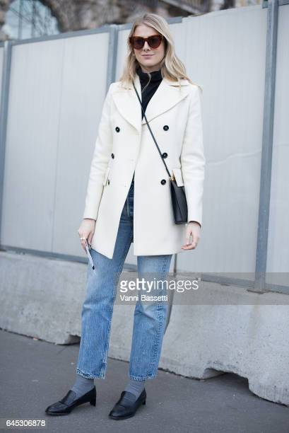 A guest poses before the Jil Sander show during Milan Fashion Week Fall/Winter 2017/18 on February 25 2017 in Milan Italy