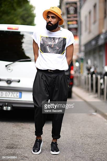 A guest poses before the Marni show during the Milan Men's Fashion Week Spring/Summer 2017 on June 18 2016 in Milan Italy