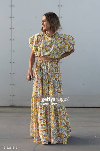 A guest poses in a floral dress ahead of Runway 1 at Melbourne Fashion Festival on March 11 2020 in Melbourne Australia
