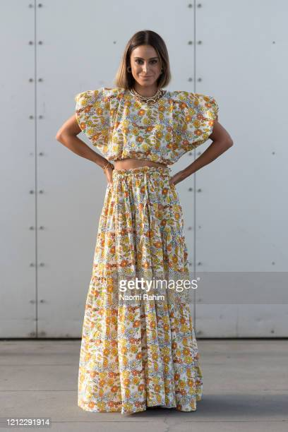 Guest poses in a floral dress ahead of Runway 1 at Melbourne Fashion Festival on March 11, 2020 in Melbourne, Australia.