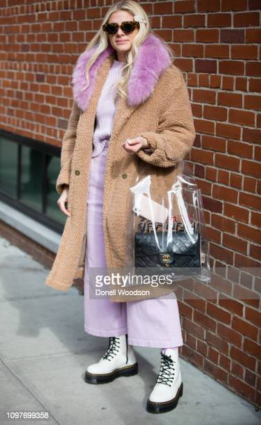 A guest poses outside of the Lanyu show wearing a fur jacket and black and white shoes during New York Fashion Week on February 10 2019 in New York...