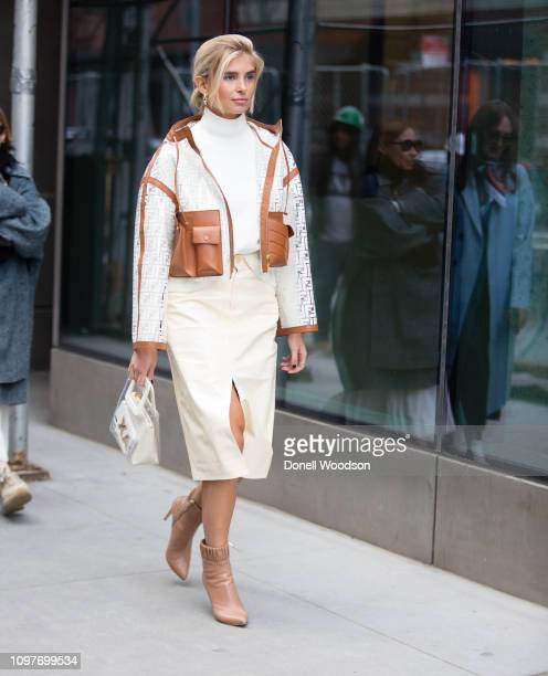 A guest poses outside of the Tibi show during New York Fashion Week on February 10 2019 in New York City