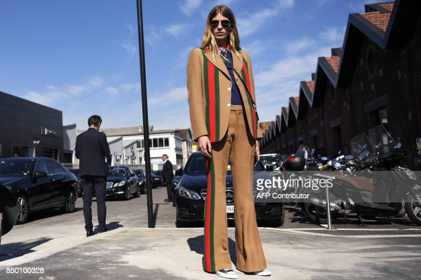 A guest poses outside the show for fashion house Gucci during the Men and Women's Spring/Summer 2018 fashion shows in Milan on September 20 2017 /...