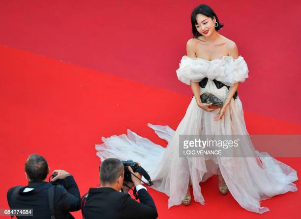 A guest poses upon arriving on May 17 2017 for the screening of the film 'Ismael's Ghosts' during the opening ceremony of the 70th edition of the...