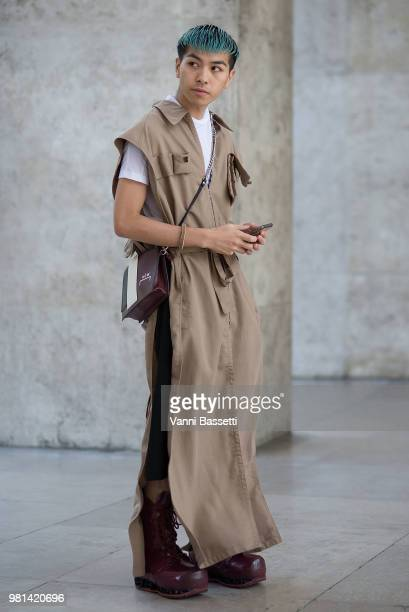 A guest poses wearing a Barragan coat A Cold Wall bag and Raf Simons boots before the Ann Demeulemeester show at the Palais de Tokyo during Paris...