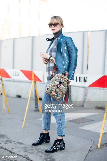 A guest poses wearing a Celine jacket and a Gucci backpack before the Jil Sander show during Milan Fashion Week Fall/Winter 2017/18 on February 25...