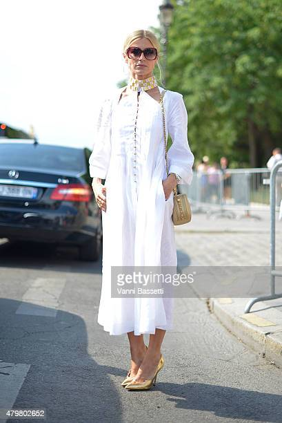 A guest poses wearing a Chanel dress before the Chanel show at the Grand Palais on July 7 2015 in Paris France