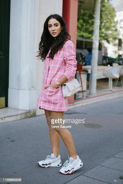 Guest poses wearing a Chanel jacket and bag and Just Cavalli sneakers after the Valentino Show during Paris Fashion Week - Haute Couture Fall/Winter...