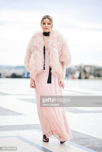 A guest poses wearing a Chloe dress before the Elie Saab show at the Theatre National de Chaillot during Haute Couture Spring Summer 16 on January 27...