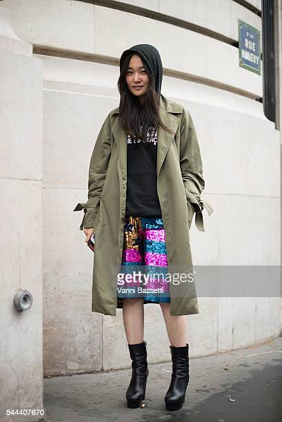A guest poses wearing a Comme des Garcons sweatshirt before the Vetements show at Galeries Lafayette during Paris Fashion Week Haute Couture FW16/17...