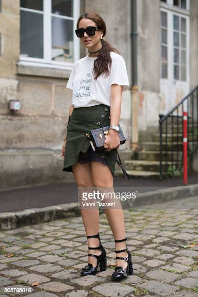 A guest poses wearing a Dior tshirt Louis Vuitton bag and Miu Miu shoes before the Rodarte show at the Cloitre Port Royal during Paris Fashion Week...