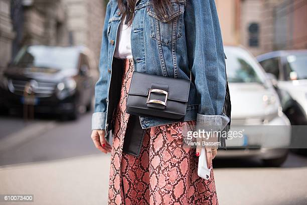 A guest poses wearing a Free Madonna skirt and Roger Vivier bag after the Maxmara show during Milan Fashion Week Spring/Summer 2017 on September 22...