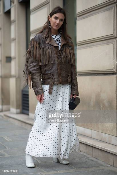A guest poses wearing a fringed leather jacket after the Jean Paul Gaultier show during Paris Fashion Week Haute Couture Spring Summer 2018 on...