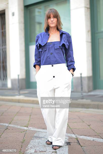 A guest poses wearing a Gentucca Bini suit before the Salvatore Ferragamo show during the Milan Fashion Week Spring/Summer 16 on September 27 2015 in...