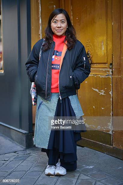 a18122bc0 A guest poses wearing a Gosha Rubchinskiy sweatshirt and a GVGV bomber  jacket before the Schiaparelli