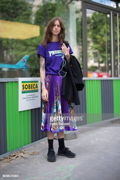 A guest poses wearing a Gosha Rubchinskyi tshirt before the Elie Saab show at the Pavillion Cambon during Paris Fashion Week Haute Couture FW 17/18...