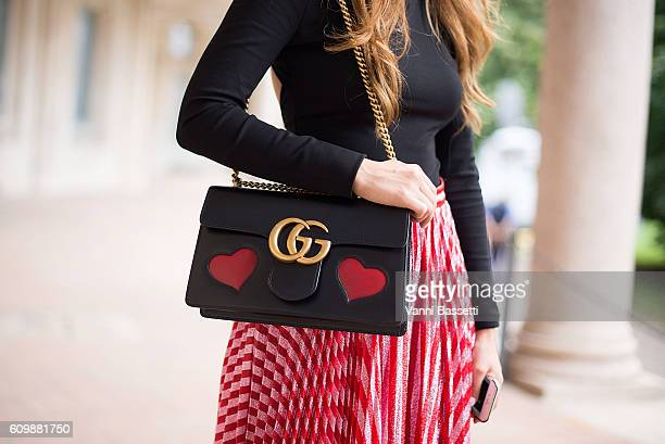 A guest poses wearing a Gucci skirt and bag before the Alberta Ferretti show during Milan Fashion Week Spring/Summer 2017 on September 21 2016 in...