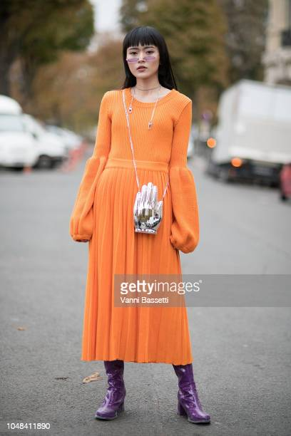 A guest poses wearing a Ksenia Schneider dress after the Chanel show at the Grand Palais during Paris Fashion Week SS19 Womenswear on October 2 2018...
