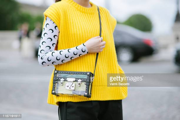 Guest poses wearing a Marine Serre top and Louis Vuitton bag after the Louis Vuitton show at Place Dauphine during Paris Fashion Week - Menswear...