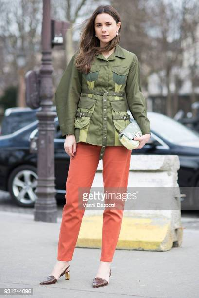 A guest poses wearing a Marques Almeida jacket and a Chanel bag after the Chanel Show at the Grand Palais during Paris Fashion Week Womenswear FW...