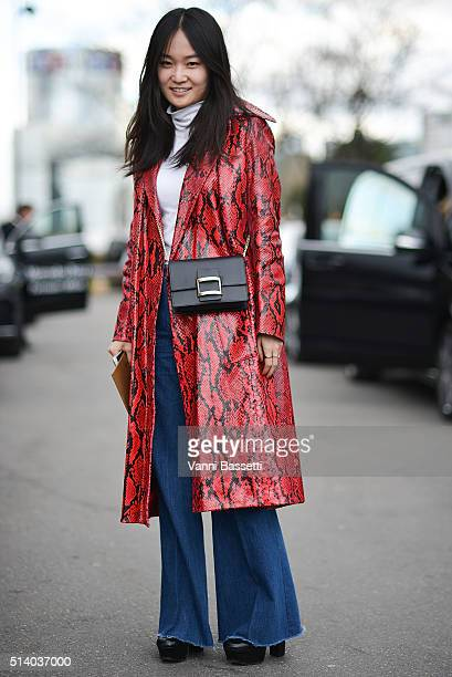 A guest poses wearing a Miu Miu coat after the Celine show at the Tennis Club de Paris show during Paris Fashion Week FW 16/17 on March 6 2016 in...