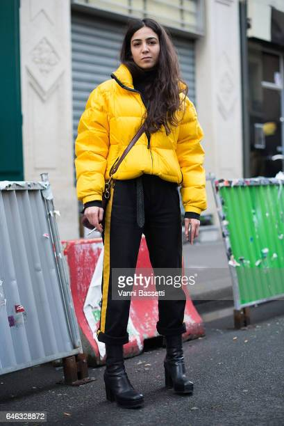 A guest poses wearing a Ralph Lauren down before the Koche show at the Folies Bergere during Paris Fashion Week Womenswear FW 17/18 on February 28...