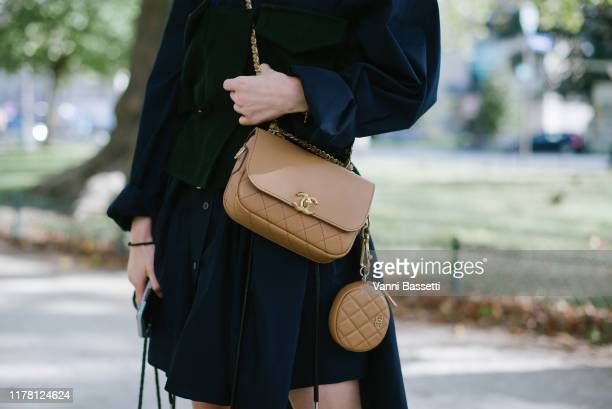 Guest poses wearing a Sacai dress and a Chanel bag after the Sacai show at the Grand Palais during Paris Fashion Week - Womenswear Spring Summer 2020...