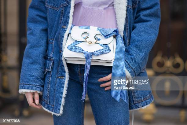 A guest poses wearing a sherpa trucker jacket and a JW Anderson bag before the Stella McCartney show at the Opera Garnier during Paris Fashion Week...