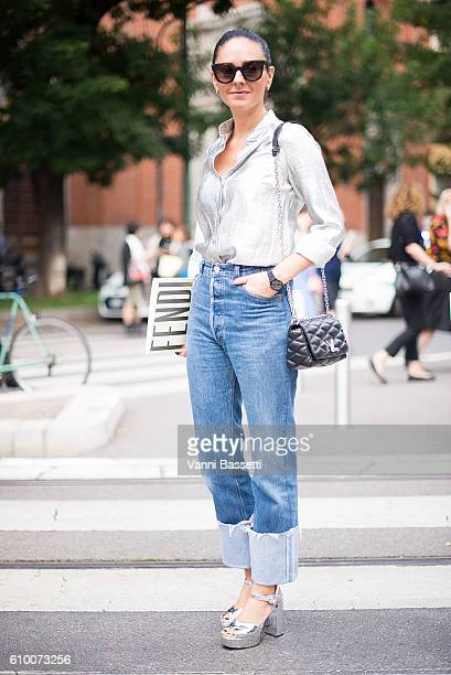 A guest poses wearing a Stella McCartney shirt after the Fendi show during Milan Fashion Week Spring/Summer 2017 on September 22 2016 in Milan Italy