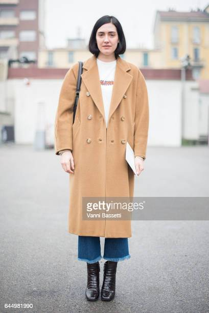 A guest poses wearing a Sunnei tshirt after the Lucio Vanotti show during Milan Fashion Week Fall/Winter 2017/18 on February 24 2017 in Milan Italy