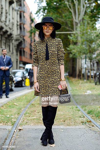 Guest poses wearing a vintage dress, Chanel bag and Cline jewelery on September 17, 2014 in Milan, Italy.