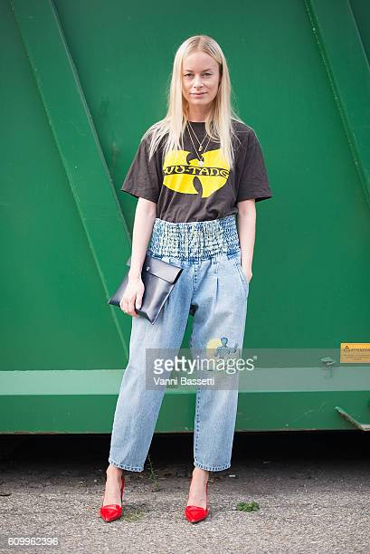 A guest poses wearing a Wutang Clan tshirt after the Diesel Black Gold show during Milan Fashion Week Spring/Summer 2017 on September 23 2016 in...