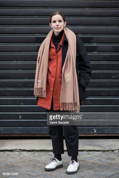 A guest poses wearing Acne Studios after the Acne Studios show during Paris Fashion Week Haute Couture Spring Summer 2018 on January 24 2018 in Paris...