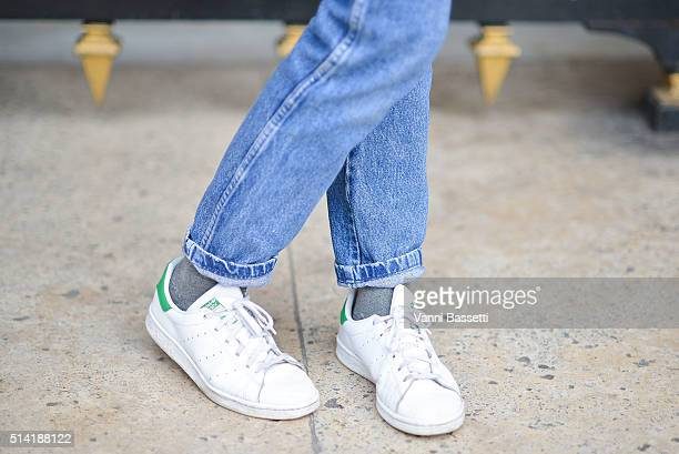 A guest poses wearing Adidas Stan Smith before the Stella McCartney show at the Opera Garnier during Paris Fashion Week FW 16/17 on March 7 2016 in...