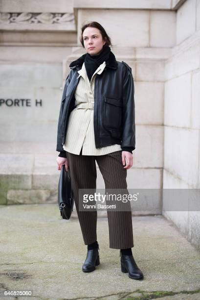 Guest poses wearing an Acne Studios jacket after the Maison Margiela show at the Grand Palais during Paris Fashion Week Womenswear FW 17/18 on March...