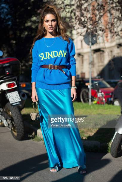 A guest poses wearing an Alberta Ferretti jumper and Chloe bag after the Alberta Ferretti show during Milan Fashion Week Spring/Summer 2018 on...