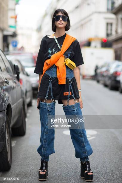 A guest poses wearing an Heron Preston tshirt and Y Project pants before the Hed Mayner show during Paris Fashion Week Menswear SS19 on June 22 2018...
