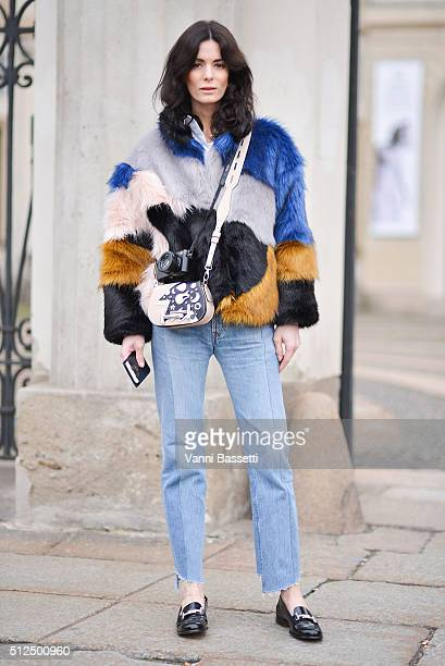 A guest poses wearing an Hofmann Copenhagen fur Vetements pants and Tod's bag and shoes before the Tod's show during the Milan Fashion Week...