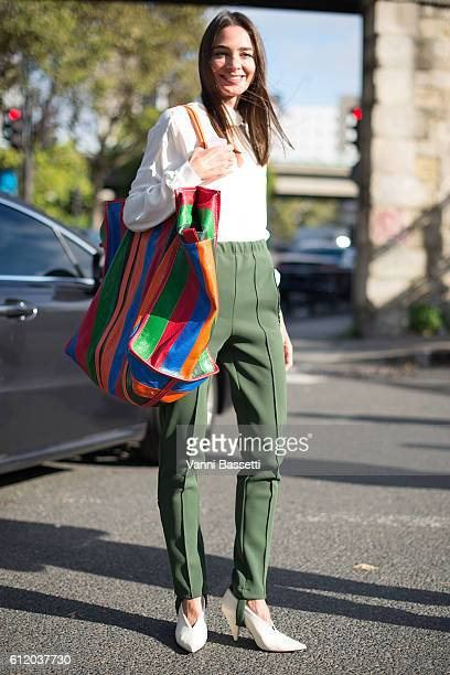 A guest poses wearing Balenciaga after the Balenciaga show at the Paris Event Center during Paris Fashion Week Womenswear SS17 on October 2 2016 in...
